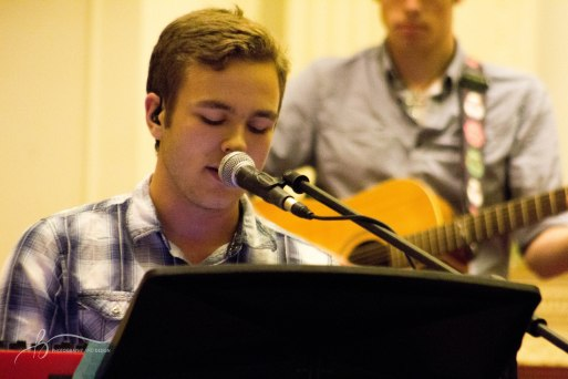 Kyle Mears leads worship and plays piano at the CRU weekly meeting.