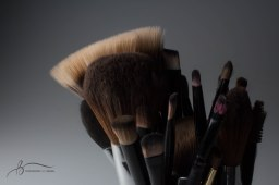 Makeup brushes sit on the lighting table in the studio on Sunday, March 12, 2017. || Becca Tapp © 2017